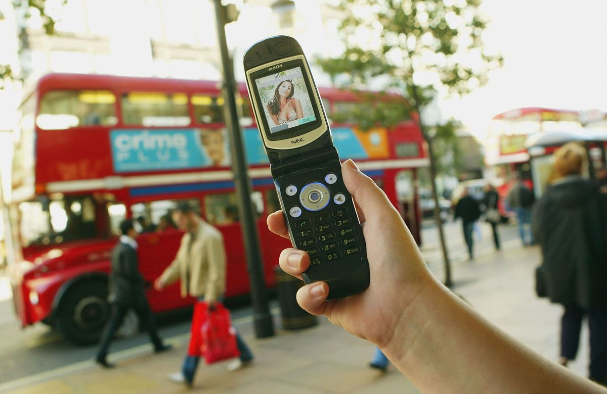LONDON - OCTOBER 16: A '3' network mobile phone is held on Oxford Street October 16, 2003 in London, England.  The 3 network became available in 60% of the UK during July 2003. 3 is the first to offer 2-way mobile video calling in the UK. (Photo by Scott Barbour/Getty Images)