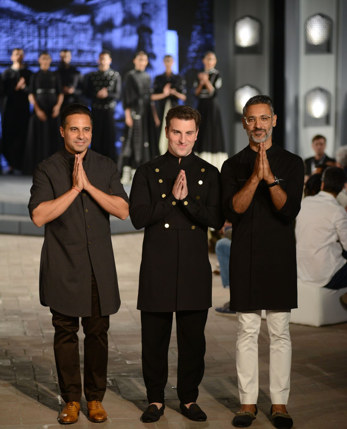 Brian Chesky with Indian celebrity designer duo Shantanu and Nikhil at an event in Delhi, India.
